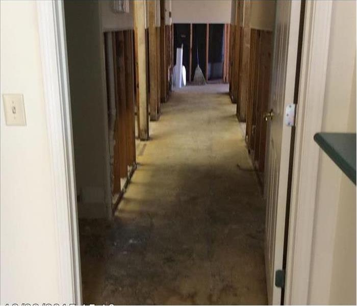 Hallway with doors and drywall removed