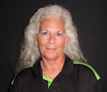 female employee with white hair and a SERVPRO black and green top