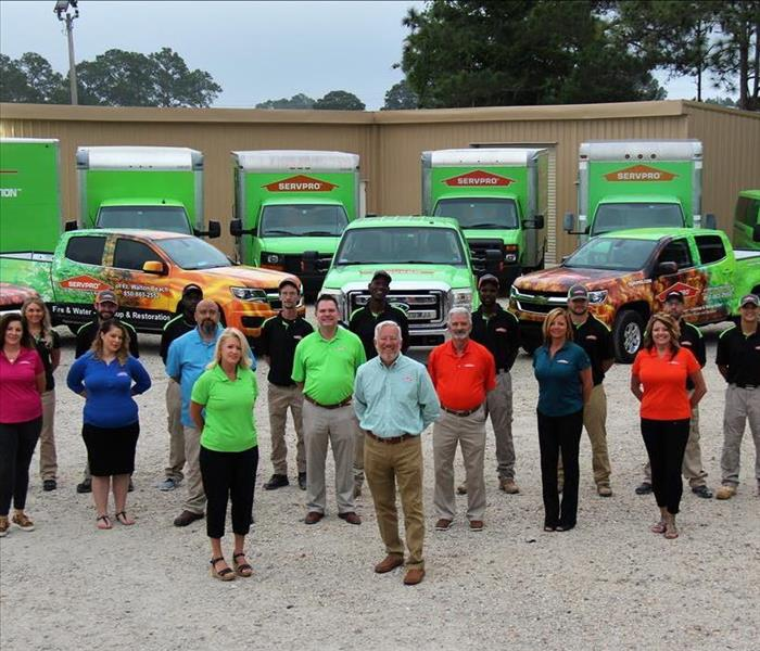 SERVPRO Employees Outside office with trucks in the background