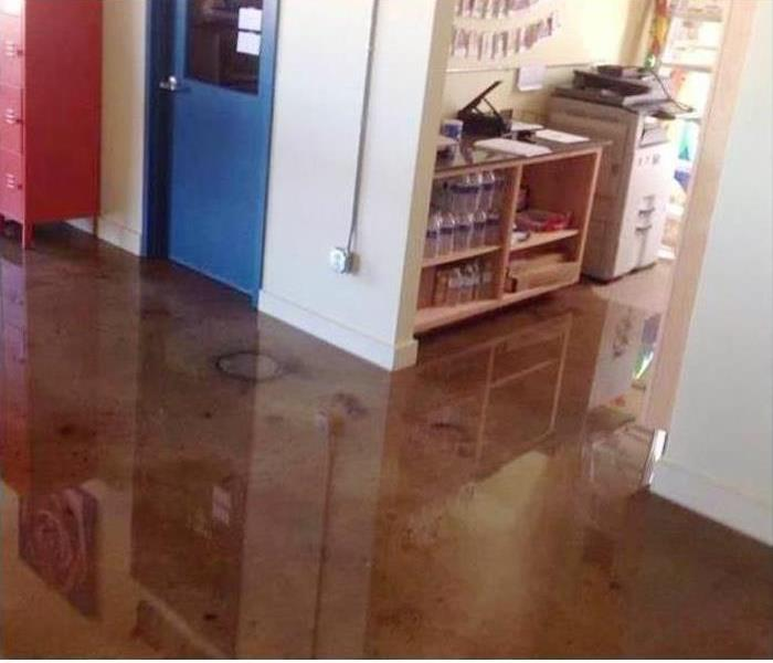 Water on a wooden floor in a commercial building