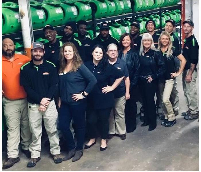 SERVPRO team members standing in front of SERVPRO equipment